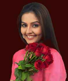 A south Indian Independent escorts in Bangalore with rose flowers in her hand